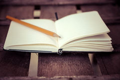 Notepad with pen on wood table Royalty Free Stock Photo