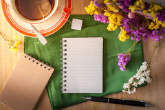 Notepad with pen on wood table stock image