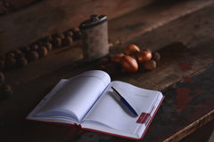 Notepad with pen on a wooden desk Stock Images