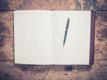 Notepad and pen on a wooden table Royalty Free Stock Image