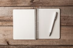 Notepad with pen on a wooden table stock images