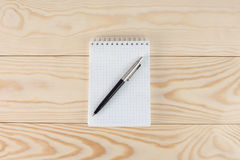 Notepad with pen on  wooden table Stock Photos