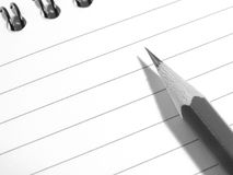 Notepad with pencil. Spiral notepad with pencil fragment Stock Photography