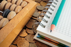 Notepad with pencil and abacus Royalty Free Stock Photos