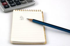 Notepad, Pencil and Calculator Stock Photography