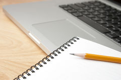 Notepad Pencil and Computer Laptop Royalty Free Stock Photography