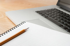 Notepad Pencil and Computer Laptop Stock Image