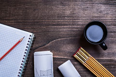 Notepad pencil construction drawings wooden meter. And cup of coffee on wood board maintenance concept stock photos