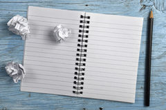 Notepad with pencil and crumpled papers Stock Image