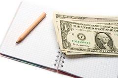 Notepad, pencil, dollar Royalty Free Stock Photos
