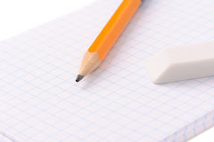 Notepad with pencil and eraser Royalty Free Stock Photos