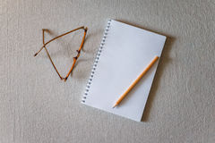 Notepad and pencil Stock Photo