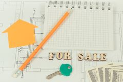 Notepad with pencil, home key and dollar on housing plan, selling and buying house or flat concept stock images