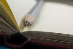 Notepad and pencil macro shot. Copy space for text Stock Photo