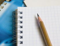 The notepad and pencil Royalty Free Stock Photography