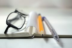 Notepad with pencil and pen points Royalty Free Stock Image