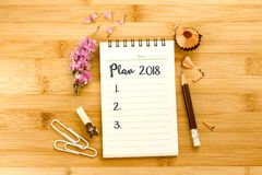 Notepad with  pencil and Plan 2018 text on a wooden table , ove Stock Images
