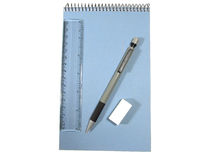 Notepad, pencil, ruler and elastic in composition. Notepad, pencil, ruler and elastic in isolated composition Stock Photography