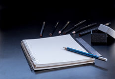 Notepad,pencil,ruler  and gift box on PVC board black Stock Image