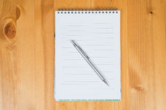 Notepad and pencil. Top view Royalty Free Stock Images