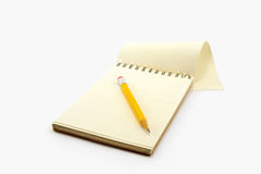 Notepad and pencil on the white background Royalty Free Stock Photos