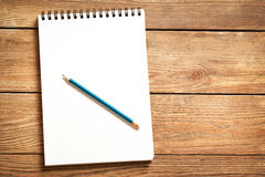 Notepad and Pencil on Wood Stock Image