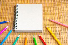Notepad with pencil on wood board background. using wallpaper or background for education, business photo. Take note of the produc Royalty Free Stock Images