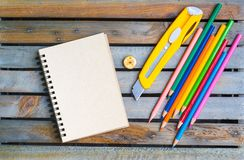Notepad with pencil on wood board background. using wallpaper or background for education, business photo. Take note of the produc Royalty Free Stock Photos