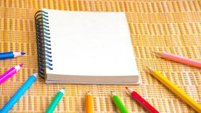 Notepad with pencil on wood board background. using wallpaper or background for education, business photo. Take note of the produc. T for book with paper and Stock Photography