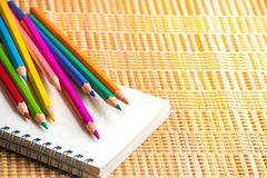 Notepad with pencil on wood board background. using wallpaper or background for education, business photo. Take note of the produc. T for book with paper and Royalty Free Stock Photos