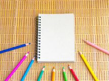 Notepad with pencil on wood board background. using wallpaper or background for education, business photo. Take note of the produc. T for book with paper and Royalty Free Stock Photography