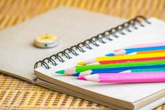 Notepad with pencil on wood board background. using wallpaper or background for education, business photo. Take note of the produc. T for book with paper and Royalty Free Stock Photo