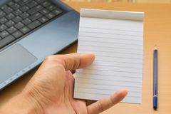 Notepad with pencil on wood board background. using wallpaper or background for education, business photo. Take note of the produc Stock Image