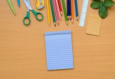 Notepad with pencil on wood board background. using wallpaper or background for education, business photo. Take note of the produc. T for book with paper and Royalty Free Stock Images