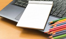 Notepad with pencil on wood board background. using wallpaper or background for education, business photo. Take note of the produc Stock Images