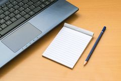Notepad with pencil on wood board background. using wallpaper or background for education, business photo. Take note of the produc Stock Photo