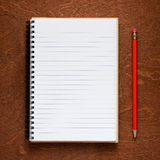 Notepad and pencil on wood Stock Photos