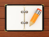 Notepad and pencil on wooden background Royalty Free Stock Images