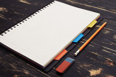 Notepad and pencil on wooden table Royalty Free Stock Photography