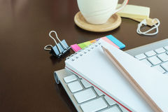 Notepad with pencil in workspace Stock Photography