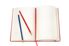 Notepad and pencils Stock Images