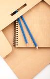 Notepad, pencils and paper folder Stock Photos