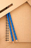 Notepad, pencils and paper folder Stock Images