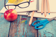 Notepad, pencils, scissors, paper clips and glasses. Royalty Free Stock Photos