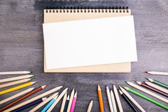 Notepad and pencils Stock Image