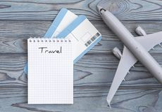 Notepad, plane tickets on a wooden background. travels. Notepad, air tickets on a wooden background. travel, tourism, air travel, vacation Royalty Free Stock Images