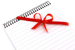 Notepad with red bow stock photo