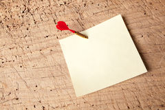Notepad with red dart Stock Images