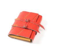 Notepad. Red Leather Closed Notepad With Buckles Isolated On White Background Royalty Free Stock Image