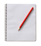 Notepad and red pencil. On a white background Royalty Free Stock Photos